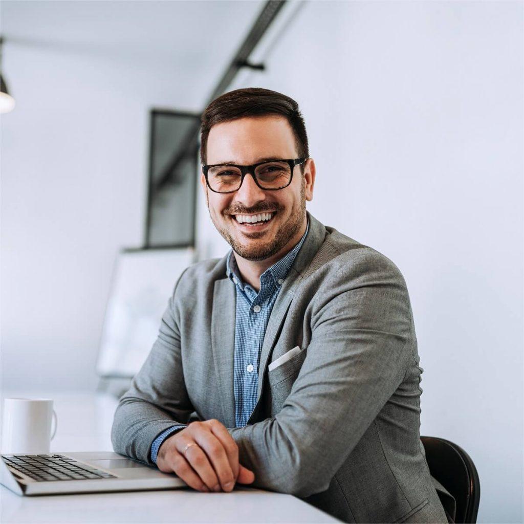 smiling-man-at-desk