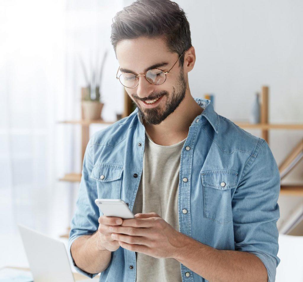 man-using-mobile-smiling